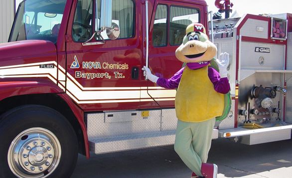 The Wally Wise safety mascot with a fire truck