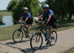 Two officers ride bikes