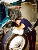Worker inspects vehicle