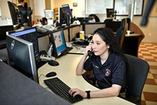 Police dispatcher answers phone